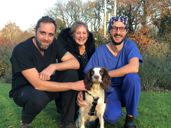 Springer spaniel Star with Cave Veterinary Specialists clinicians Alex Hamilton (left) and Simon Bertram (right), with relieved owner Susan Trigg (centre).